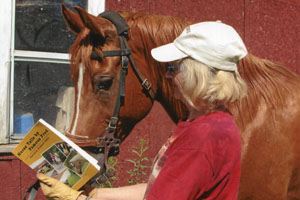 Author and her Arabian horse, Sani, reading her book Horse Tails by Famous Fred